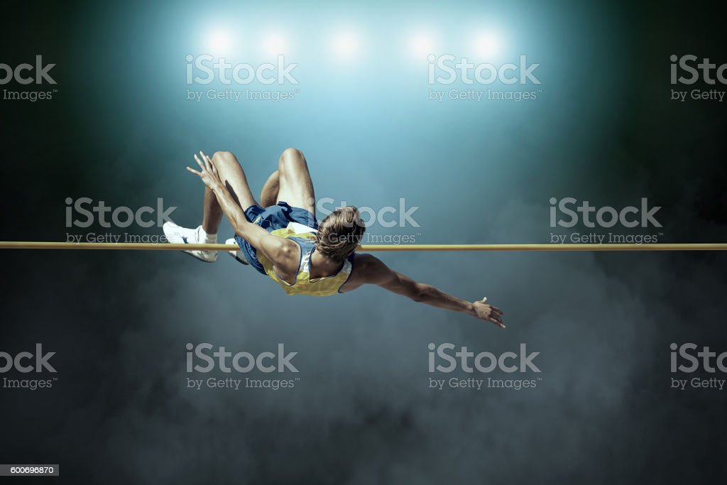 Athlete in action of high jump. stock photo