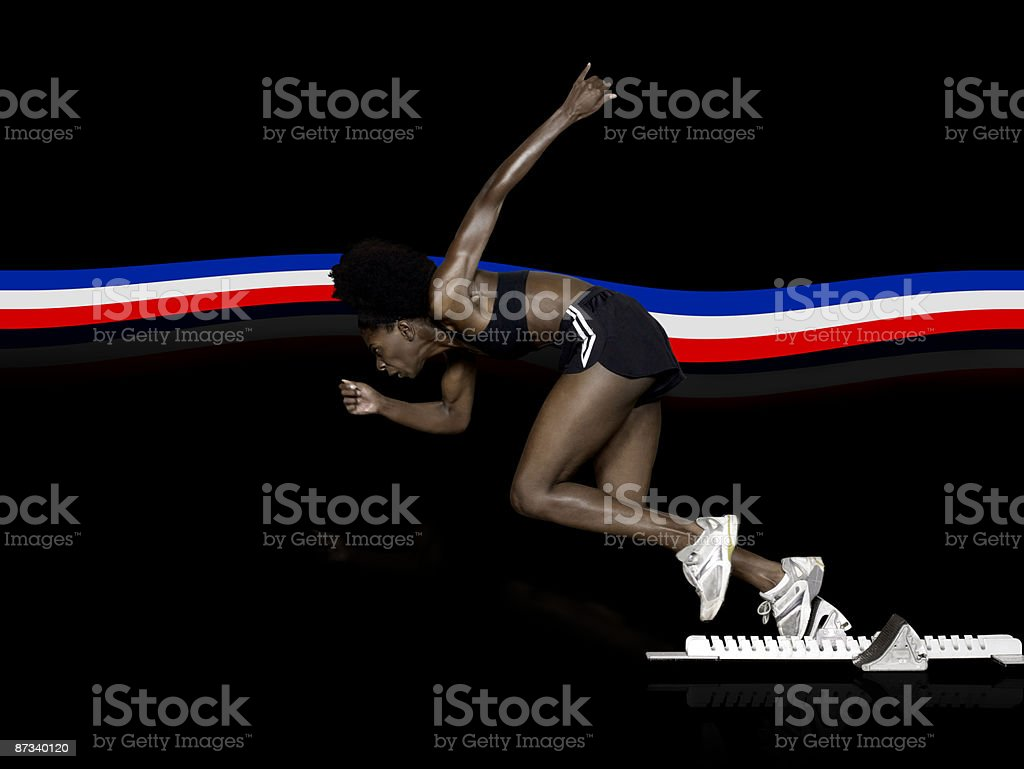Athlete in starting blocks stock photo