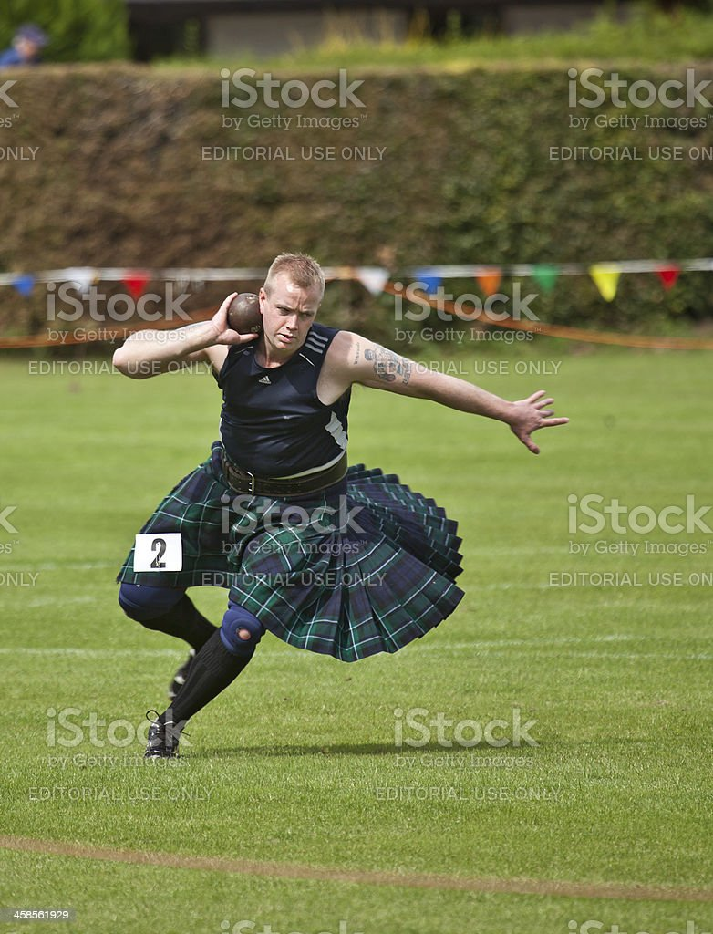 Athlete in the shot put competition, Brodick Highland Games stock photo