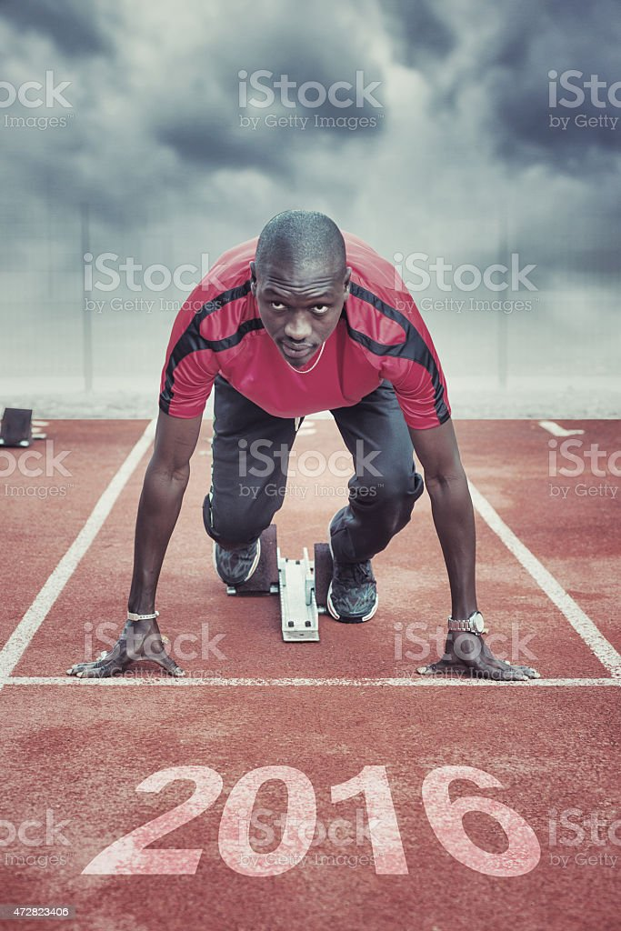Athlete in the starting block for race stock photo