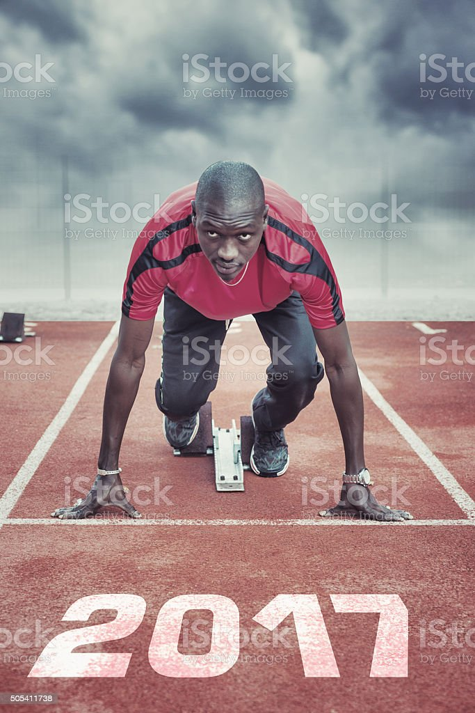 Athlete in the starting blocks stock photo