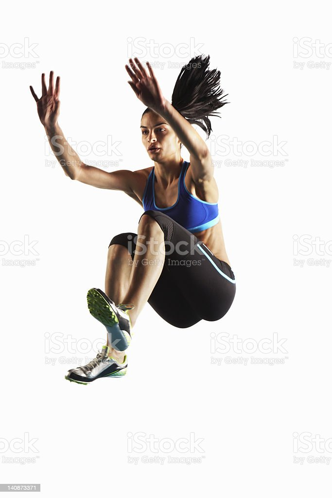 Athlete jumping in mid air stock photo