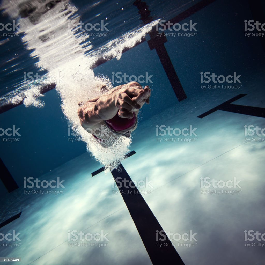Athlete jumping int the water stock photo