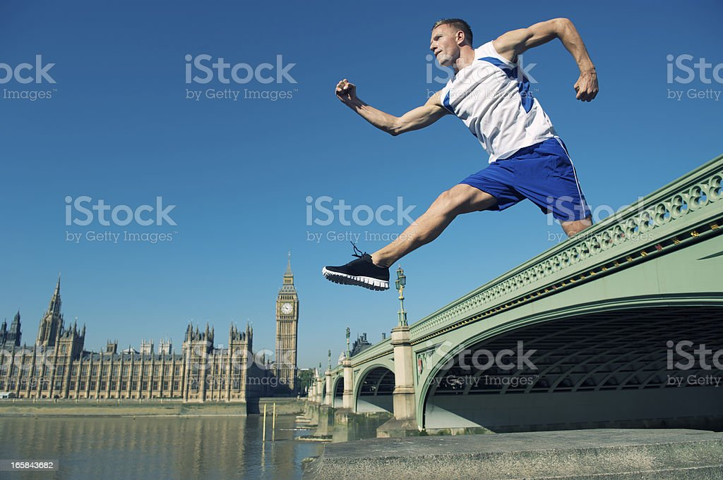 Athlete Jumps Over Westminster Bridge London royalty-free stock photo