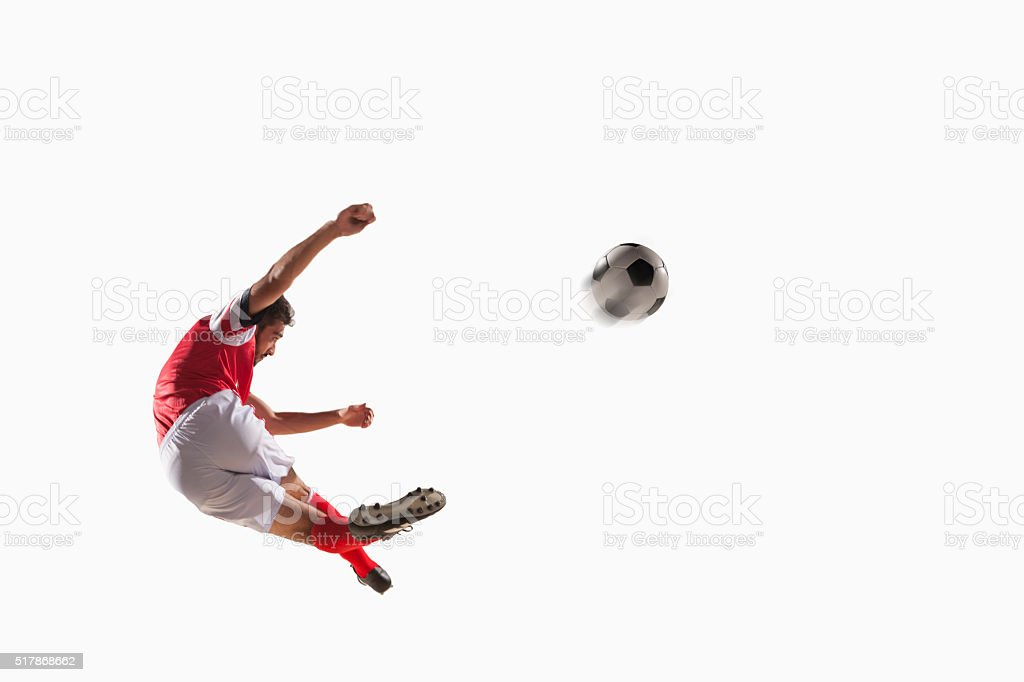 Athlete kicking soccer ball stock photo