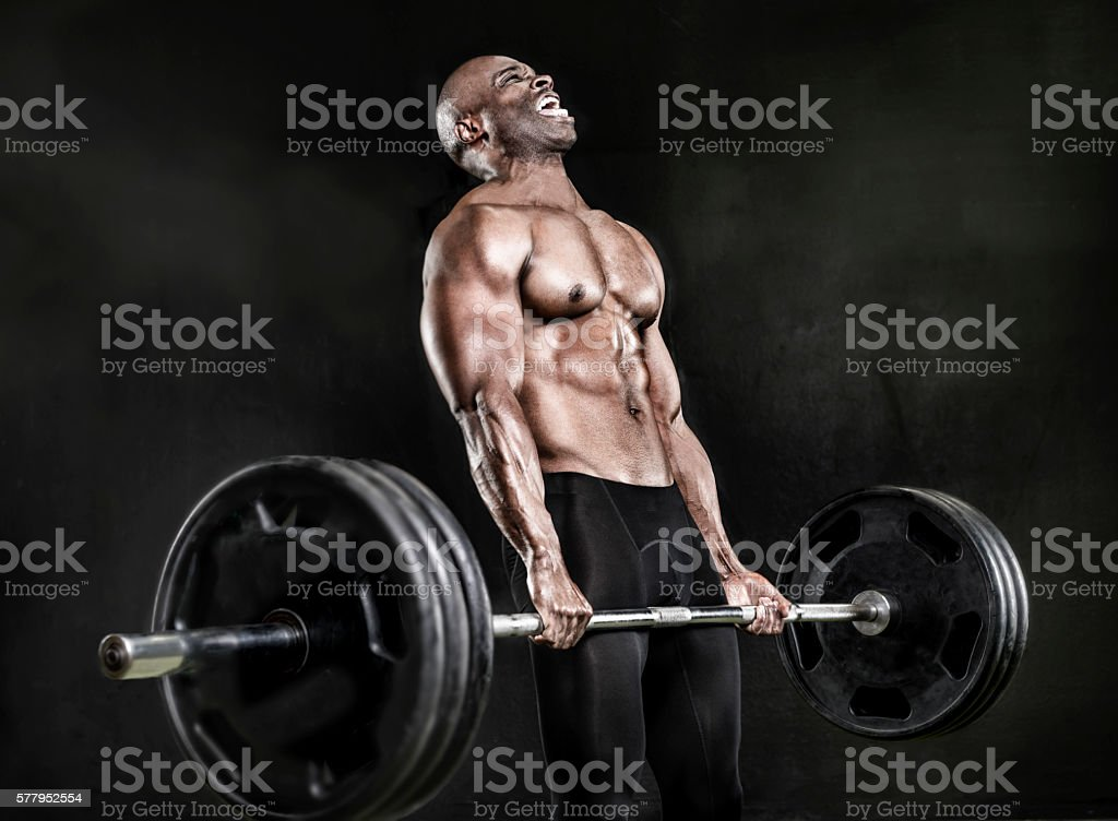 Athlete lifting heavy weights stock photo
