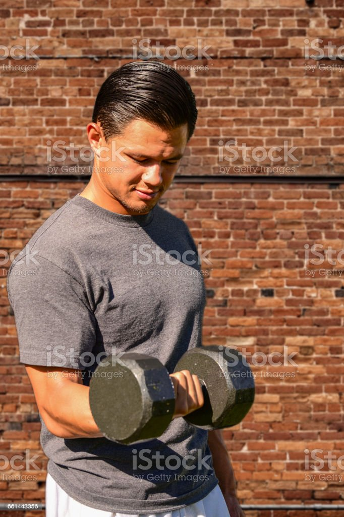 Athlete Lifting Weights stock photo
