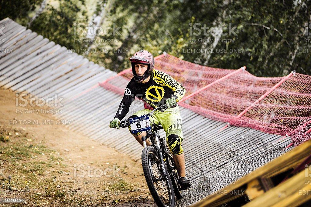 athlete man extreme cyclist riding Insloped Turn stock photo