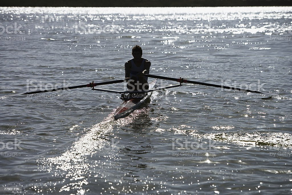 Athlete on a small row boat royalty-free stock photo