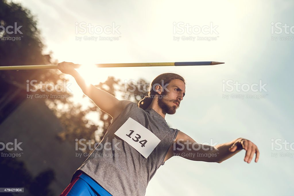 Athlete on competition ready to throw a javelin. stock photo