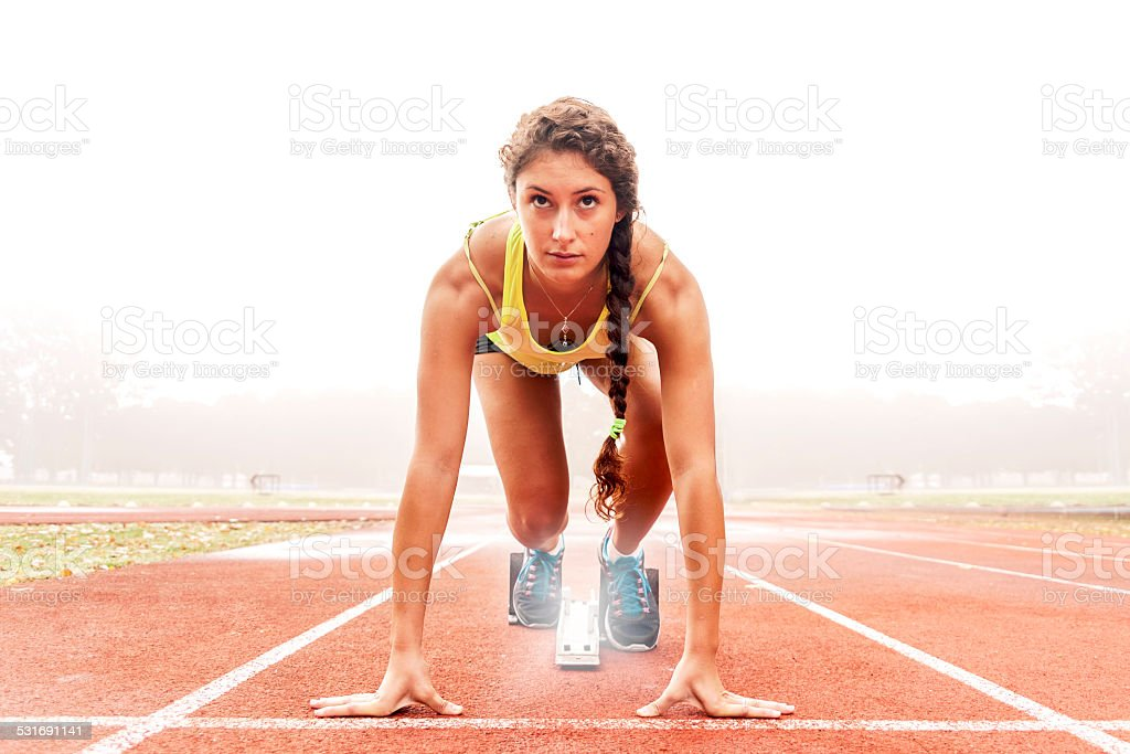athlete on the starting blocks stock photo