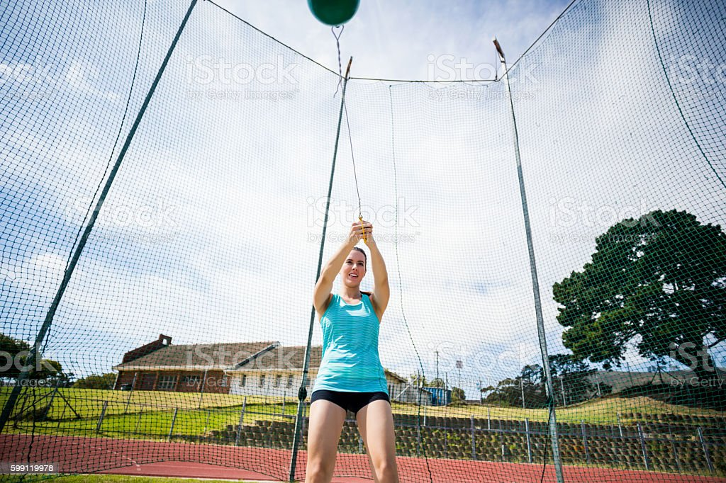 Athlete performing a hammer throw stock photo