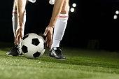 Athlete placing soccer ball for corner kick on field