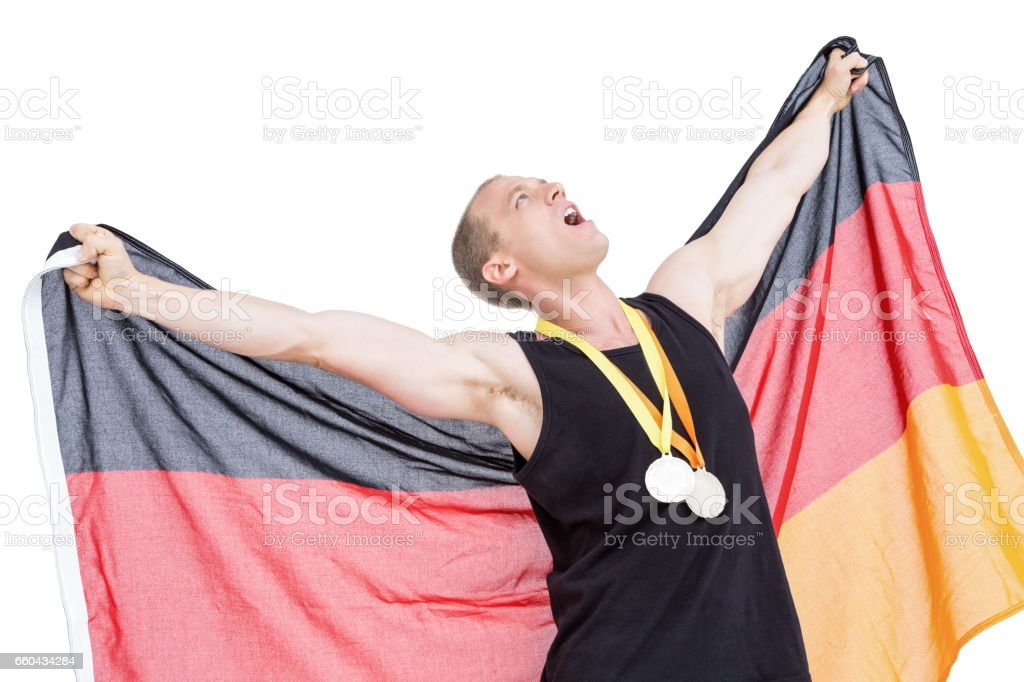 Athlete posing with olympic gold medals around his neck royalty-free stock photo