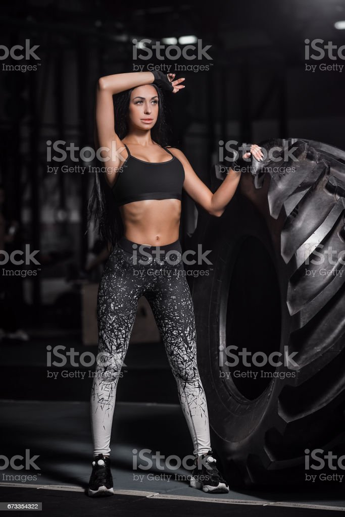 Athlete resting after a hard workout. Exercise with heavy weight in the gym. stock photo