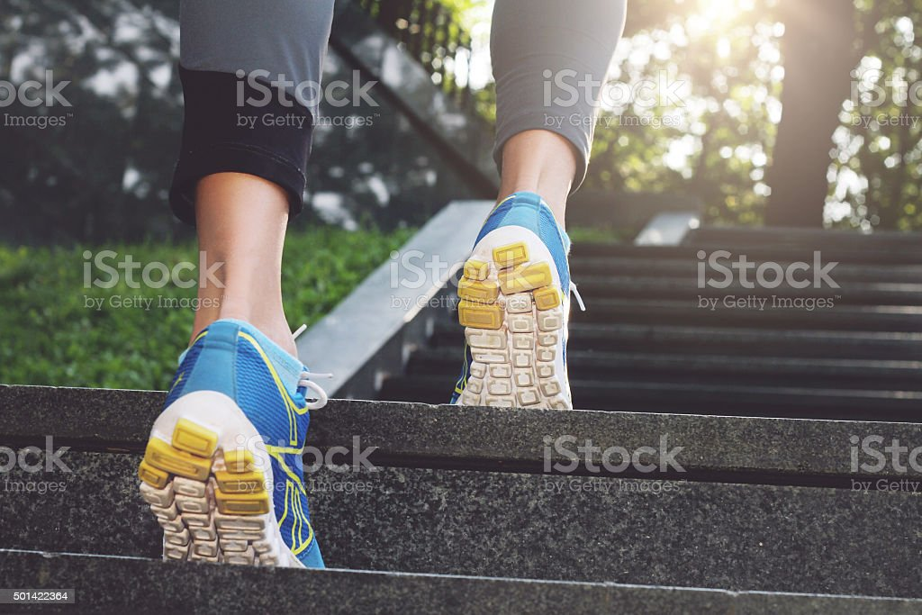 Athlete runner feet running in nature, closeup on shoe. stock photo