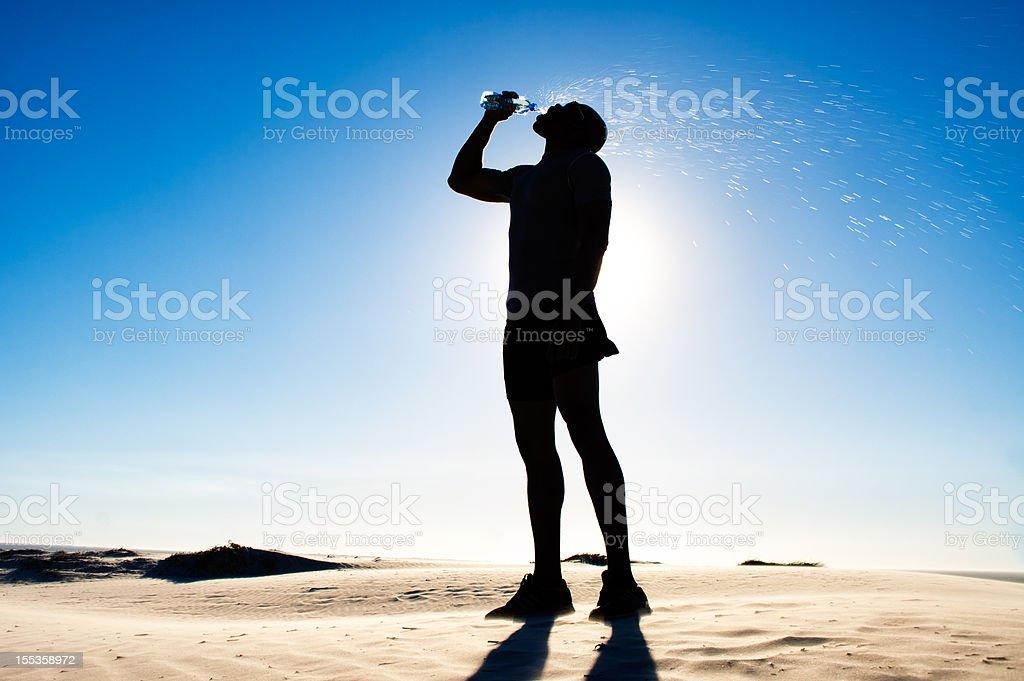 Athlete Runner Resting on Sand Dune royalty-free stock photo