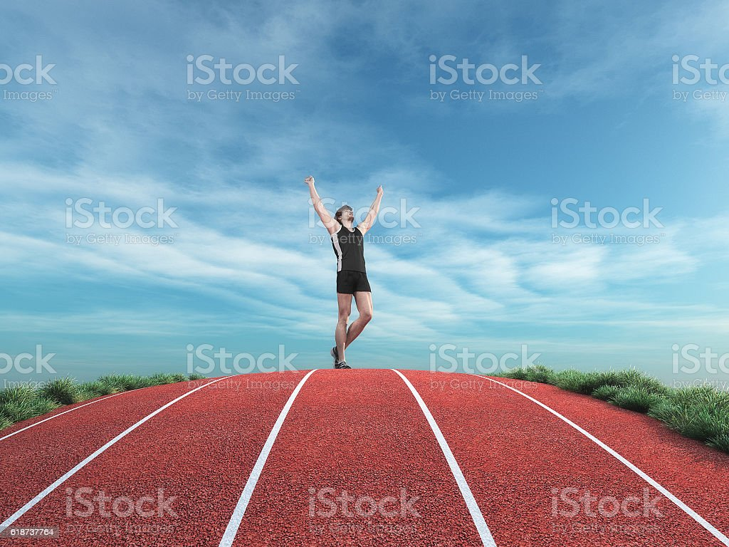Athlete runner rises his hands to the sky stock photo