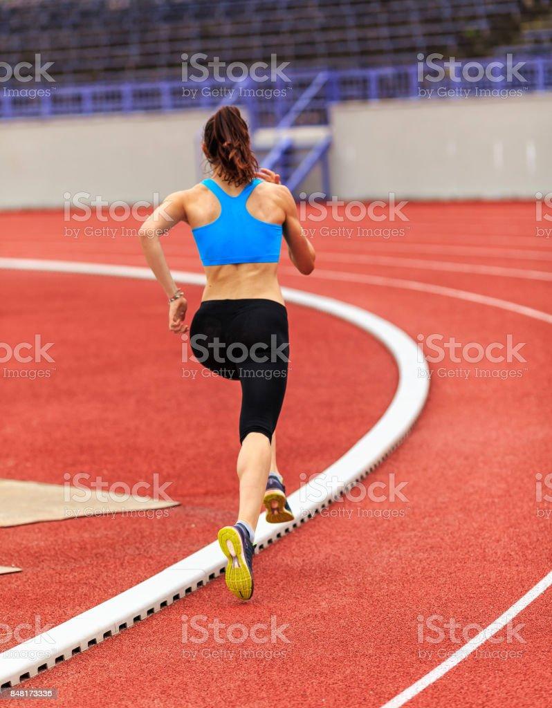 Athlete running at the stadium stock photo