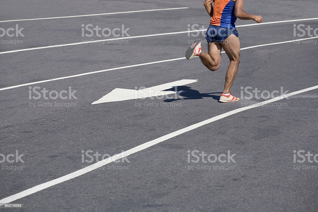 Athlete running in the city wrong way stock photo