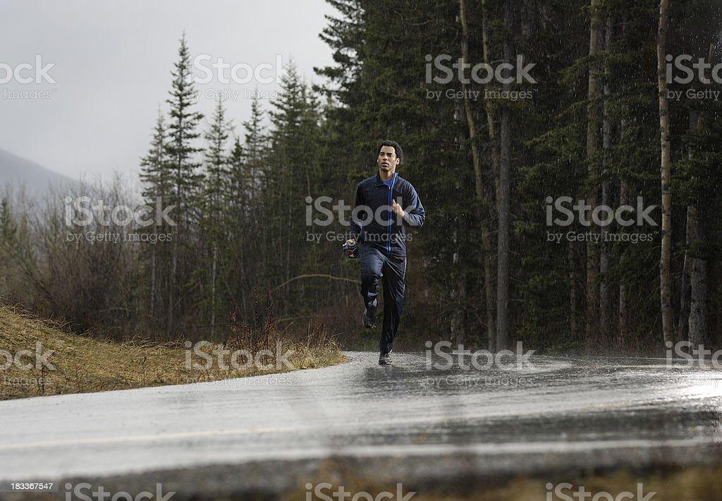 Athlete running in the rain stock photo