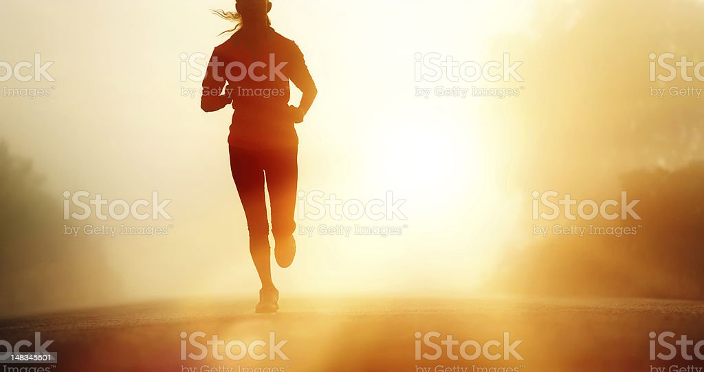 Athlete running road silhouette stock photo