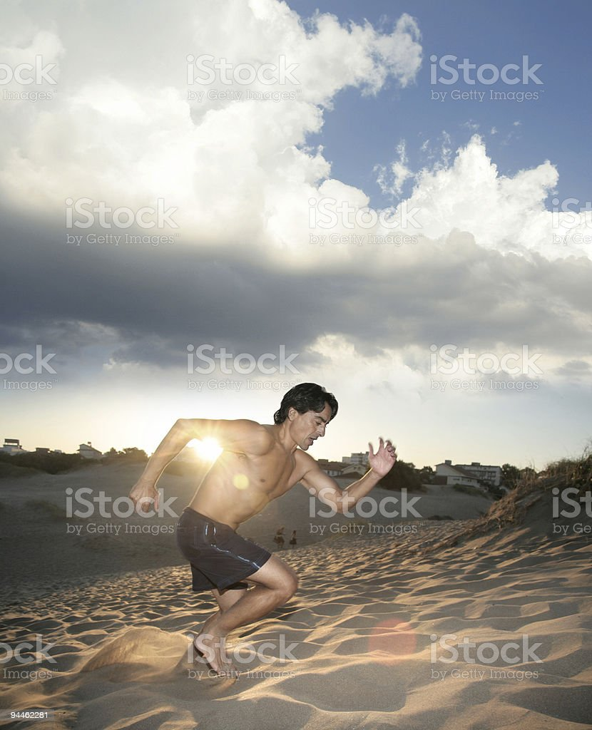 Athlete running up the hill royalty-free stock photo