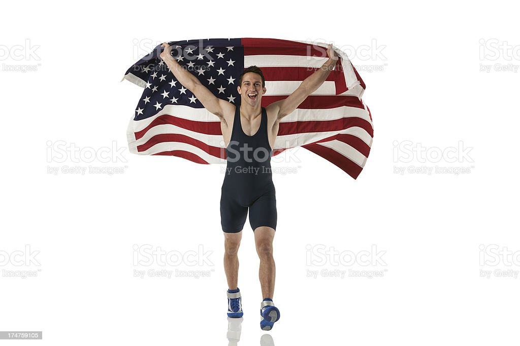 Athlete running with an American flag stock photo