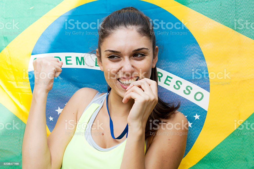athlete shows the gold medal winner stock photo