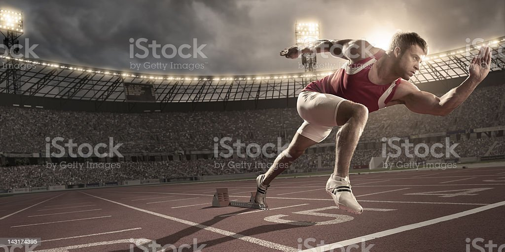 Athlete Sprinting From Blocks stock photo