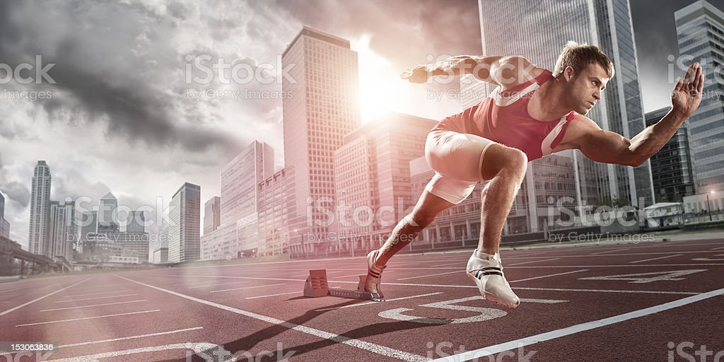 Athlete Sprinting in City stock photo