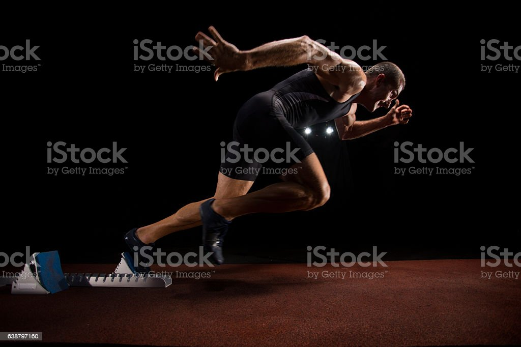 Athlete sprinting on track stock photo