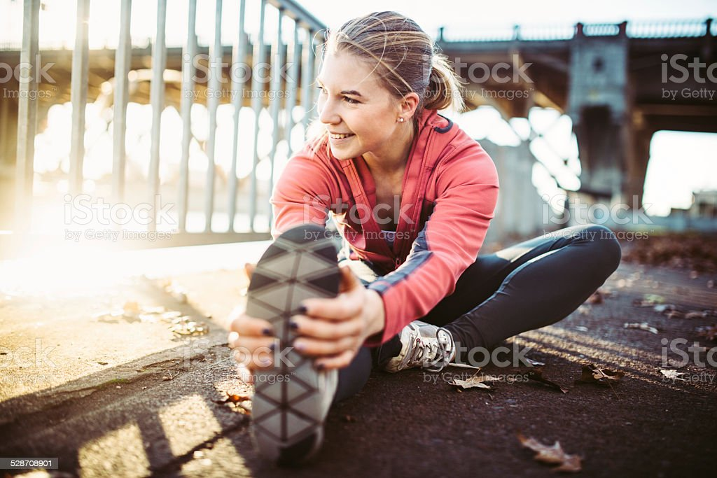 Athlete Stretching at Portland Waterfront stock photo