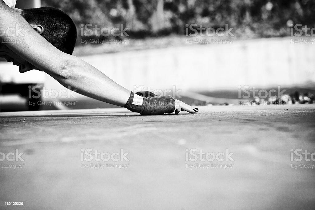 athlete stretching stock photo