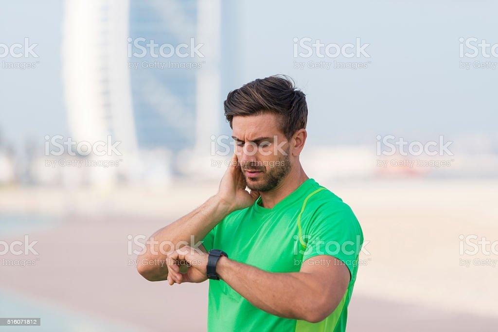 Athlete taking his pulse stock photo