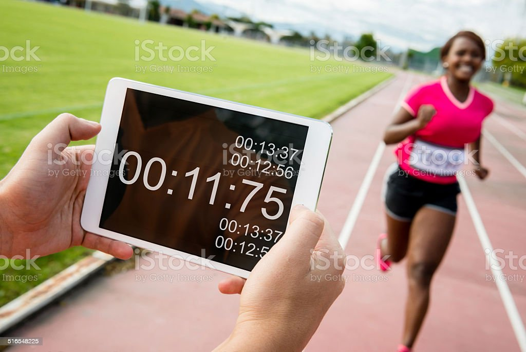 Athlete timing her perfomance stock photo