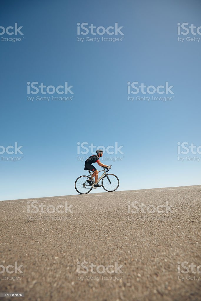 Athlete training for cycling event of triathlon stock photo