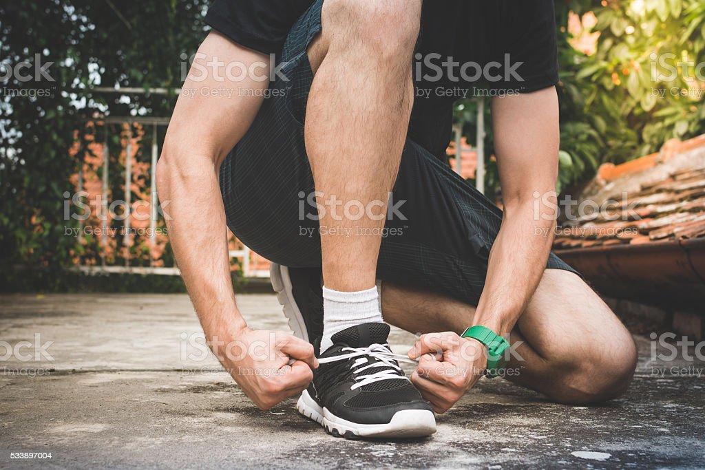 Athlete tying shoes stock photo