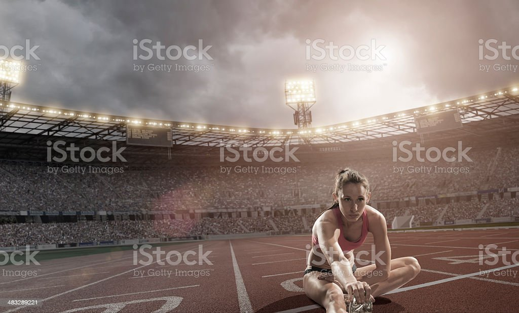 Athlete Warm Up Stretches royalty-free stock photo