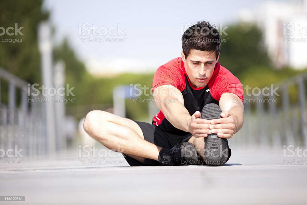 Athlete warming and stretching royalty-free stock photo