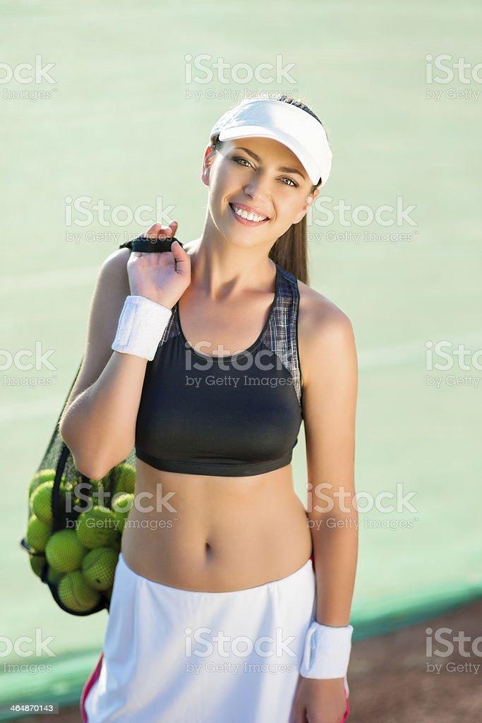 Athlete with a Plenty of Tennis Balls royalty-free stock photo