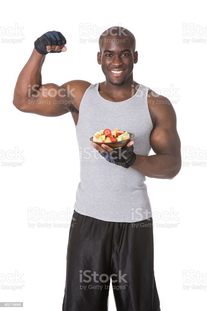 Athlete with Bowl of Fruit royalty-free stock photo
