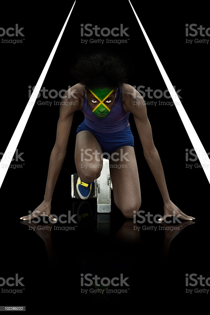 Athlete with jamaican flag face paint stock photo