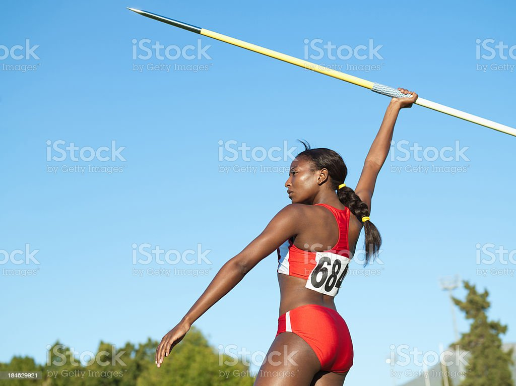 Athlete with javelin in arena stock photo