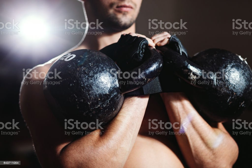 athlete with Kettlebells workout stock photo