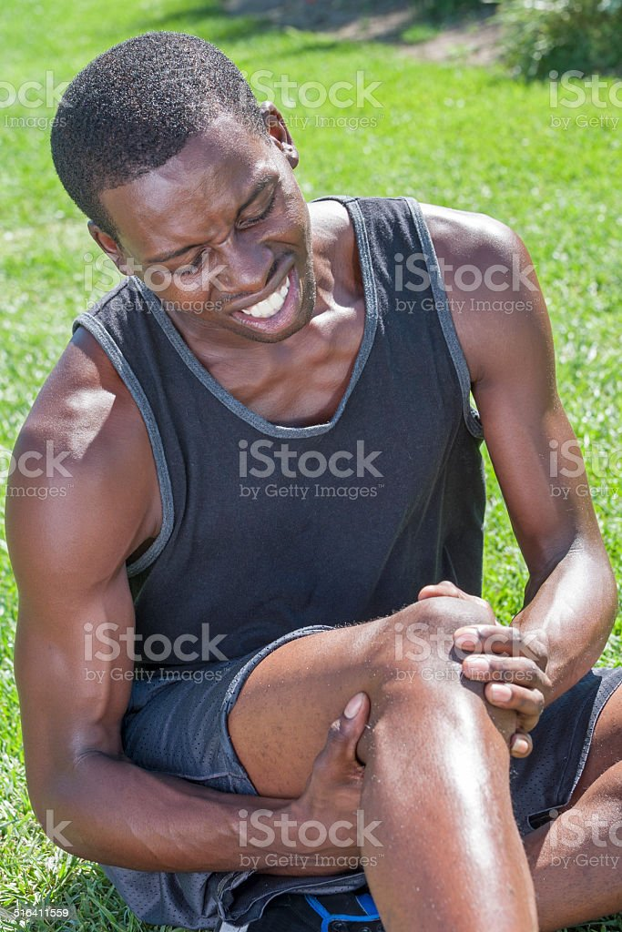 Athlete with knee injury stock photo