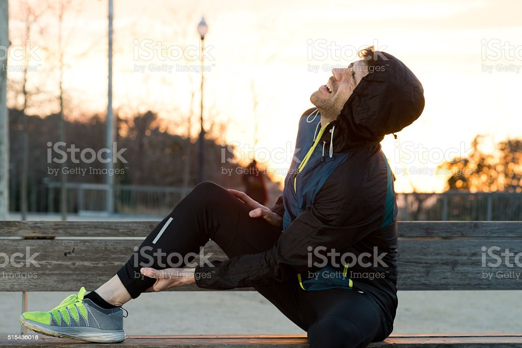 athlete with muscle pain stock photo