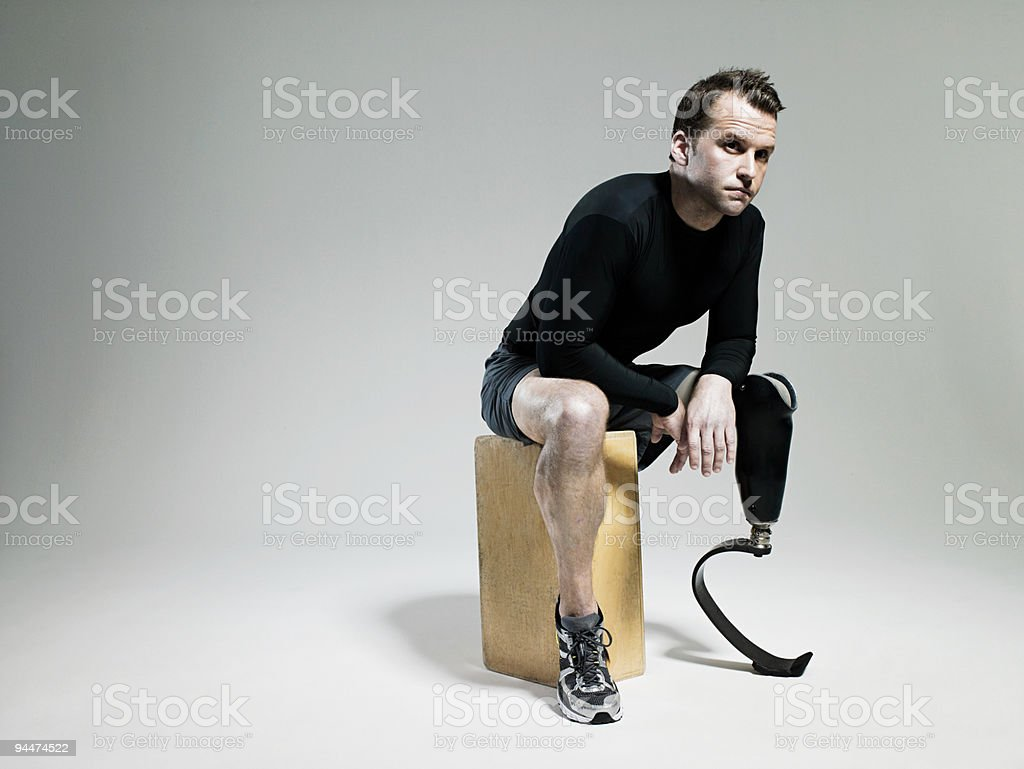 Athlete with prosthetic leg stock photo