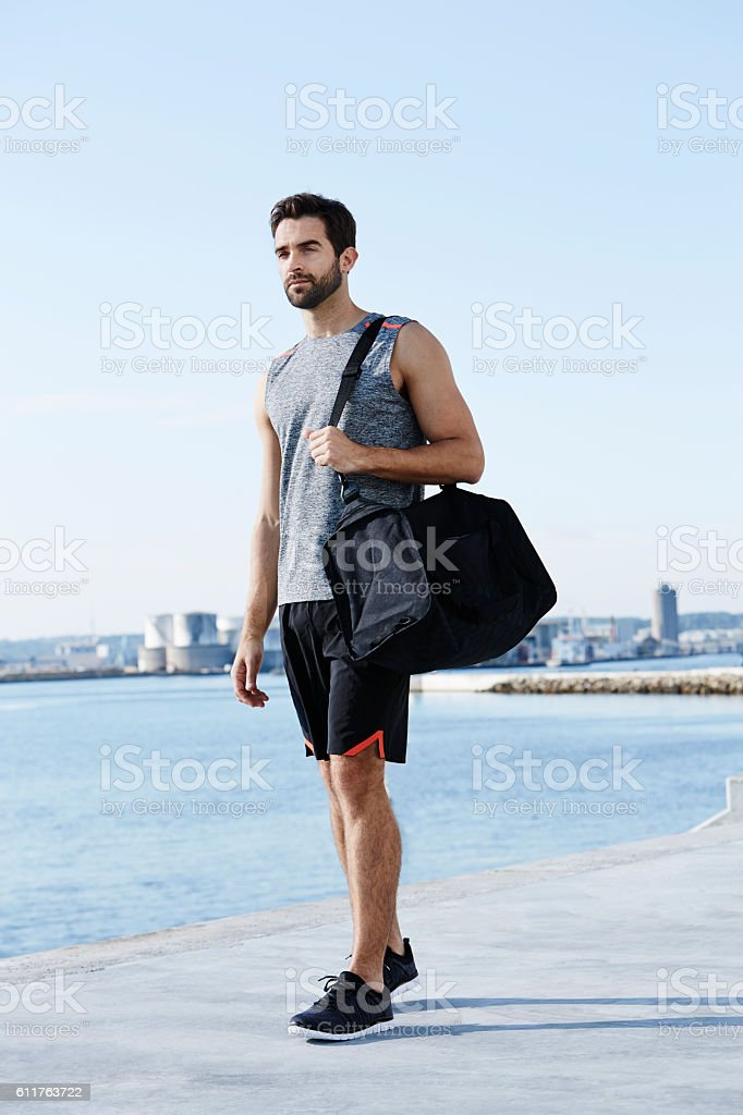 Athlete with sports bag stock photo
