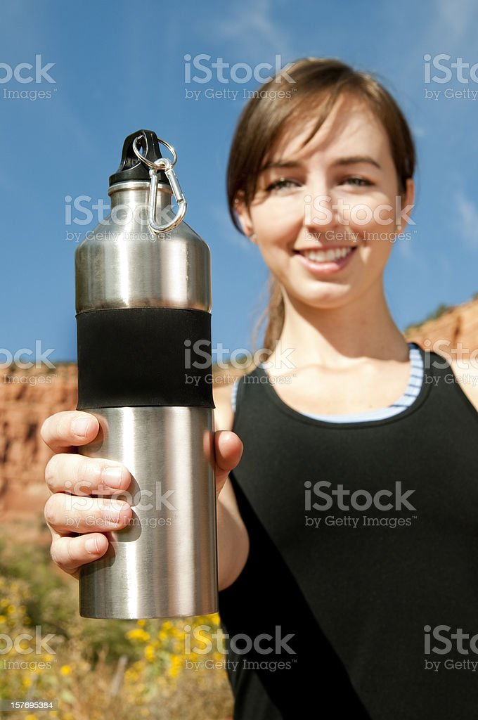 Athlete with Stainless Steel Water Bottle royalty-free stock photo